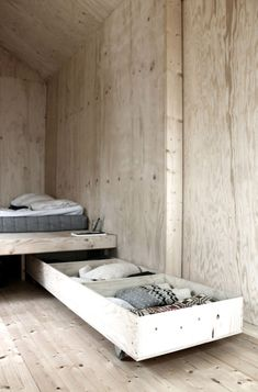 9 Ideas For Under-The-Bed Storage // The bed in this tiny cabin by SEPTEMBRE, has pull out drawers beneath it to provide maximum amounts of storage for the entire cabin.