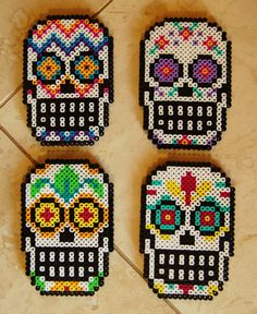 The full set of all four sugar skull perler bead coasters. Would anyone buy these if I put them on Etsy?