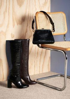 Glossy faux-croc textures lend a luxe look to any outfit. We're obsessed with these knee-high boots right now, but that cute handbag has also caught our eye.