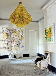 A Jacopo Foggini light fixture from Bernd Goeckler Antiques hangs in the entrance hall, which boasts paintings by George Condo (left) and Joan Mitchell as well as French sheep otto mans from John Salibello Antiques and an Empire bergère from Newel. Design Entrée, Design Trends, House Design, Design Ideas, Modern Design, Hotel Apartment, Apartment Renovation, Manhattan Apartment, Apartment Design