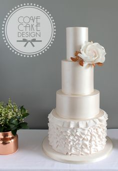 Blush lustre wedding cake with ruffles, sugar roses and copper foliage. Blush pink and copper wedding inspiration
