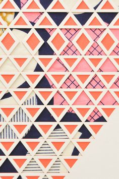 Multiple layer, laser cut artwork from designer and architect Molly McGrath. Cream and coralpapers are intricatelycut to reveal the Dutch superwax fabric behi
