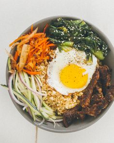 Paleo Korean Bulgogi Bowl recipe with teriyaki cauliflower rice, marinated beef, kimchi, and a fried egg Paleo Recipes, Asian Recipes, Low Carb Recipes, Cooking Recipes, Ethnic Recipes, Clean Eating, Healthy Eating, Cauliflower Dishes, Create A Recipe