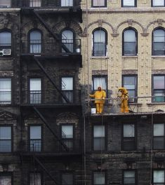 Suffolk Street. Lower East Side. Power washing a sooty building blackened from years of coal burning in the city (and sooty fuel oil)..