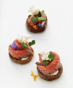 delicate beef and mushroom appetizers with edible flowers