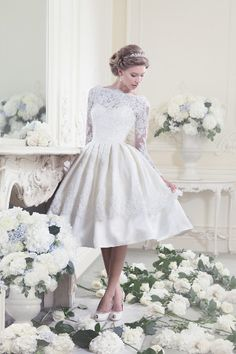 Fifties style short wedding gown ellis bridals || I'd never wear a short dress, but I love this. The top is timeless.