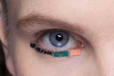 Patchwork fabric eyeliner. Fendi's runway makeup Milan fashion week by makeup artist Peter Phillips.  Photo by Imaxtree
