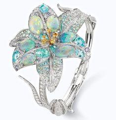 """chaumetofficialOpaline """"Etoiles boréales"""" bracelet in black opals, Paraiba tourmalines, yellow and violet sapphires. #Chaumet #LaNaturedeChaumet #Lily"""
