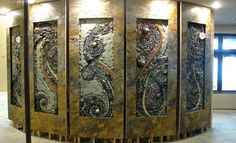 These creative pieces make up a wall but almost seem to sit in frames. Now imagine this as backsplash!