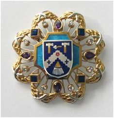 Camilla has a new badge!  The Duchess of Cornwall's Worshipful Company of Plaisterers Badge