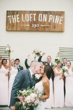 A cute kiss: http://www.stylemepretty.com/little-black-book-blog/2014/11/21/romantic-wedding-at-the-loft-on-pine/ | Photography: Onelove - http://www.onelove-photo.com/