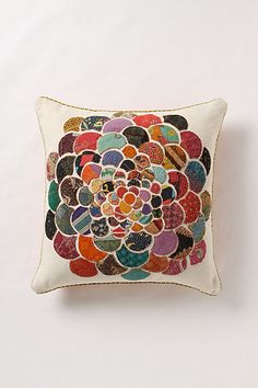 """Orimono Pillow -- Flower Jewel-tone prints reminiscent of Japanese yukatas are cut into rounded petals and patched atop cotton canvas. No two pillows are exactly alike. Side zip; Cotton; polyfill. Dry clean. 22"""" square. #anthropologie"""