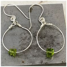 A personal favorite from my Etsy shop https://www.etsy.com/listing/514293751/peridot-and-sterling-asymmetric-earrings