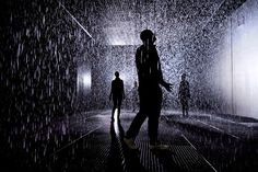 """A clever new installation at Barbican's Curve Gallery in London is getting showered with praise. Devised by UK-based rAndom International, the """"Rain Room"""" allows visitors to pass through a downpour without getting wet. Interactive Installation, Installation Art, Interactive Art, Art Installations, Interactive Exhibition, Story Starter, Room London, Rain Storm, Make It Rain"""