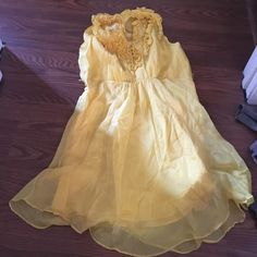 Yellow spring dress Ruffles neck with buttons. Flowy and cute! Lost the belt it came with 100% silk. Dry clean only. Never worn Dresses Mini