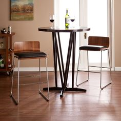 Give your feet a rest with this midcentury modern stool set! Shimmering metal legs support a curved, striated walnut finished seat that is topped off with a plush, black PU leather cushion. This design is the ultimate in style and comfort.