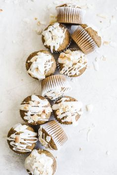 These Coconut Carrot Cake Muffins are filled with shredded carrots and toasted coconut and drizzled with a simple yet sweet coconut glaze.