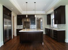 Dark Brown Cabinets With White Marble Countertops - Design photos, ideas and inspiration. Amazing gallery of interior design and decorating ideas of Dark Brown Cabinets With White Marble Countertops in bathrooms, kitchens by elite interior designers. Espresso Kitchen Cabinets, Stained Kitchen Cabinets, Kitchen Tray, Dark Cabinets, Kitchen Tiles, Kitchen Colors, Kitchen Countertops, Marble Countertops, Floors Kitchen