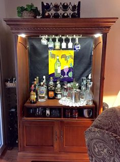Convert an old tv armoire  into a stylish bar.