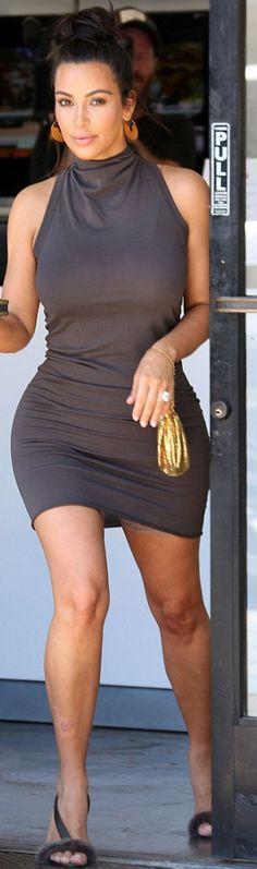 Who made  Kim Kardashian's cowl neck dress and gray sandals?