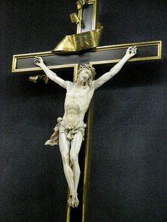 A carved Jesus ivory on a black and gold cross in the treasury of Notre Dame de Paris