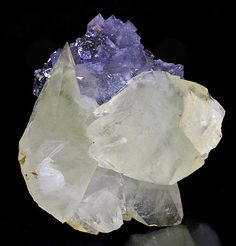 Glassy yellow crystals of Calcite with Fluorite set atop Sphalerite matrix! Several of the Calcites are doubly terminated while all are very...