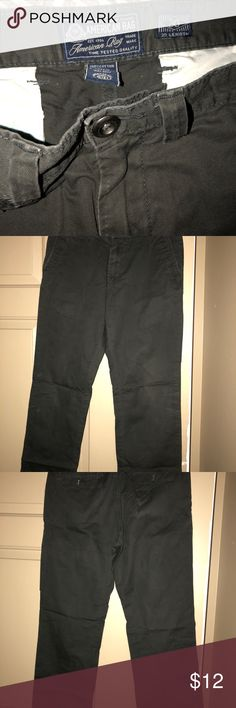 American Rag Men's slim fit casual pants 30/30 American Rag slim fit solid color casual pants for me. Slant front and buttoned back pockets. 30/30 American Rag Pants Chinos & Khakis