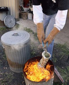 Raku Pottery Firing: glaze pottery, set into flames, cover with sawdust, close lid and the magic of Raku is the result.