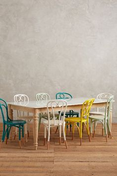 Polished Marble Dining Table - Multi-colored chairs are key - anthropologie.com