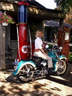 Girl on an old motorcycle