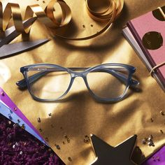 Frames this bold should be wrapped in gold. Gift stunning opticals in paper that lives up to what's inside.