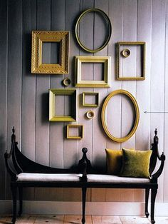 Cheap photo frames that have different shapes – can be grouped together for creating beautiful room decor with frames composition. You can fix a wooden letter inside of each frame to write a meaningful word on the wall and design very personal wall decoration.    Different frames shapes look even better