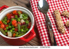 Vegetable soup on old wooden table - stock photo