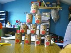 Make these out of empty cans then stack and knock down for Christmas carnival game