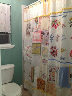Vintage Shower Curtain made out of handkerchiefs and linens with a pom pom trim