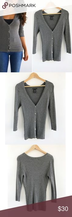 "Soft Gray Button Down Cardigan Soft Gray Button Down Cardigan! Perfect sweater to throw over! Super comfortable and stretchy. Excellent condition. Buttons down the front. Rayon, nylon, spandex blend. Chest-34"" length-24.5"" sleeve-19"" size small. New York & Company Sweaters Cardigans"