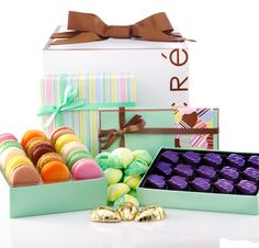 Easter Gift Box  Hop to it! Taste the Easter Bunny's collection of Easter surprises filled with Handmade Seasonal Marshmallows, 2 Dark Chocolate Peanut Butter Eggs, 1 Milk Chocolate Southern Pecan Egg, 16 piece Spring for Chocolate Collection, and an 8 piece Assorted Macaroon Collection.