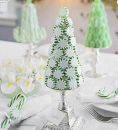 This sweet Christmas tree was made with a Styrofoam cone, onto which peppermints were glued. Displayed on pillar candlesticks,Very cute, and very easy! Via BHG. *A few of these (different heights) would be super cute as a centerpiece!