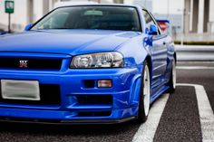 GODZILLA. good god I love this car, and I want to own one someday. Nissan Skyline GT-R R34. :)