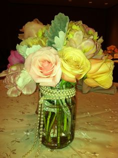 """LOVE it when I get to design for a bridal shower for one of my upcoming brides.... We get to take the """"look of the event"""" and give a fun twist!  Canning Jars with pearl wrap on """"our Jenna Lace tablecloths""""  Vintage and feminine!"""