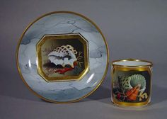 A Flight & Barr Worcester Shell-decorated Coffee Can and Saucer, Decoration by Samuel Smith, Circa 1804-10 The coffee can and saucer, each piece painted with a panel containing shells and seaweed within a gold octagonal reserve on a light-grey marble ground and a gold rim.