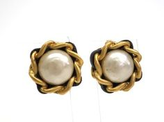 CHANEL Artificial pearl Clip Earrings Leather/Metal. Get the lowest price on CHANEL Artificial pearl Clip Earrings Leather/Metal and other fabulous designer clothing and accessories! Shop Tradesy now