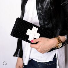 Black clutch with white cross -  made entirely with LEGO® bricks.  It's big enough to fit easily all you would usually bring to a party, opera etc. Since we get many questions about this - yes,...