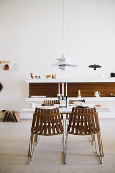 Dining room filled with Scandinavian design classics: Poul Henningsen's PH 5 lamp for Louis Poulsen hangs over the Sandra table by Thomas Sandell for Asplund and Scandia chairs by Hans Brattrud for Fjordfiesta. Photo by Christopher Wahl.