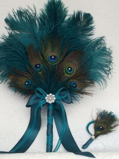 Items similar to Ostrich and Peacock Feather Fan bouquet in your choice of colors and sizes on Etsy Peacock Wreath, Peacock Crafts, Peacock Decor, Feather Crafts, Feather Art, Peacock Feathers, Peacock Theme, Peacock Centerpieces, Peacock Colors