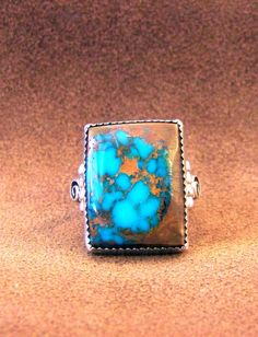 Pilot Mountain Nevada turquoise, Navajo, signed D. Secatero