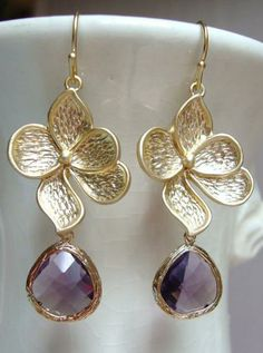 Matte Gold Dogwood Flower and Amethyst Glass Dangle Earrings from Designs by Jocelyn. Via Diamonds in the Library.