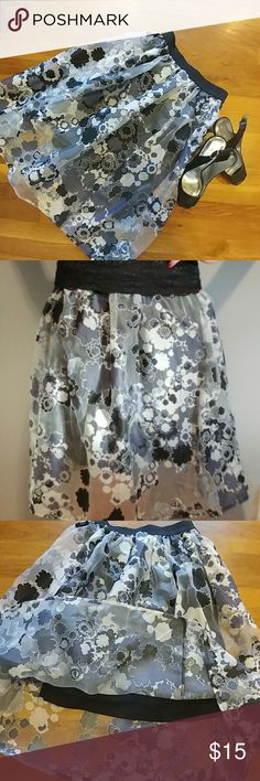 """Hot Gal size small gray floral skirt Hot Gal size small gray floral skirt fully lined Elastic waist Overall length is 25"""" Length of liner is 18"""" long  30% off a bundle of three or more items Everything is negotiable Smoke free home Pet free home All items deserve a 2nd chance at happiness Currently not trading hot gal Skirts A-Line or Full"""