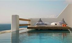 Floating deck bed hoovers over the water. by Andrea Soto Rose Floating Deck, Floating In Water, Enclosed Decks, Cavo Tagoo Mykonos, Mykonos Hotels, Tropical Houses, Back To Nature, Cool Pools, Coastal Style