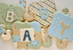 I designed these cookies for a friend whose baby shower took place over the weekend. The monogram cookies were made using the fancy square cutter from coppergifts.com and the ducklings were cut by hand. All of these were done in royal icing, which required a bit of drying time in between steps. You can see my post on how to do the tufted cookie here.